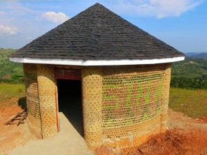 first fully upcycled learning hut at SINA out of plastic bottles, car tires and egg shells